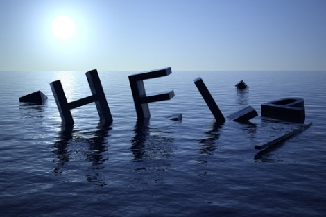 Driftwood in the shape of the word 'HELP'