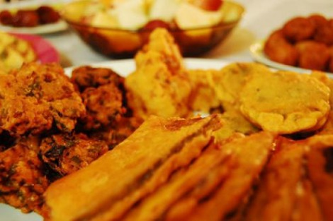 Plates of fried food at iftar feast