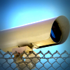 Security camera beside a chain link fence