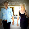 Ethan Hawke and Julie Delpy walk down a street of rural Greece in Before Midnight