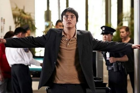Remy Hii as Van Nguyen stands spreadeagled as he is searched at Changi airport