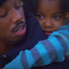 Michael B. Jordan carries young girl Ariana Neal on his back in scene from Fruitvale Station