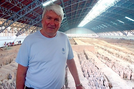 Frank Brennan stands before columns of terracotta warriors housed in a giant hangar-like museum