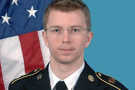 Bradley Manning offical photo, in uniform standing in front of an American flag