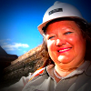Gina Rinehart wearing a miner's helmet and smiling