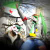 Syrian youths in masks with flags, celebrating revolution