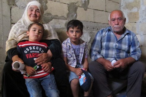 Two elderly and two young Syrian refugees
