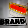 The word 'brand' applies by a branding iron
