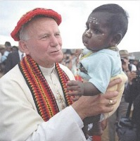 Pope John Paul II hold Aboriginal boy Liam during his famous visit to Alice Springs