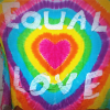 Rainbow coloured banner bearing the slogan 'Equal love'