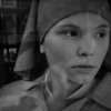 Agata Trzebuchowska in costume as young nun Ida peers out through a car window