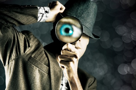 Spy with magnifying glass and enlarged eye