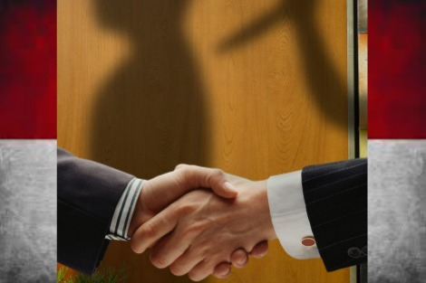 A handshake, but in the background a silhouette of one person stabbing the other in the back