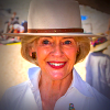 Quentin Bryce smiling, in a hat