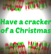 Border of Christmas crackers surrounds the words 'Have a cracker of a Christmas'