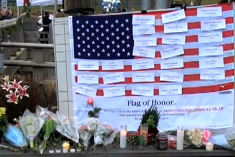 Flowers and a 'flag of honour' for those who died in the Sandy Hook shootings