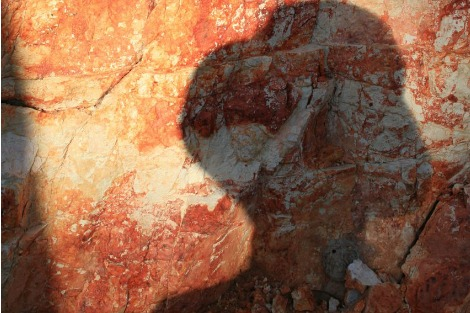 Woman's silhoutte cast on a red rock wall