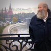 Howard Willis stands on a bridge, in the background are Moscow River and the Kremlin.