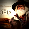Aboriginal man with Uluru in the background, from the Utopia movie poster