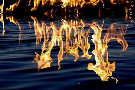 Flames reflected in water