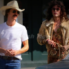 Matthew McConaughey with handlebar moustache and cowboy hat, and Jared Leto in drag, in a scene from Dallas Buyers Club