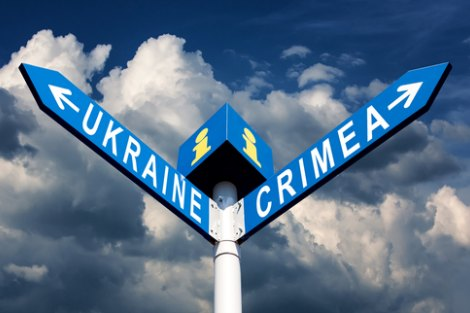 Ukraine and Crimea street signs against ominous cloudy sky