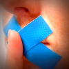 Woman with blue tape on mouth, finger before lips