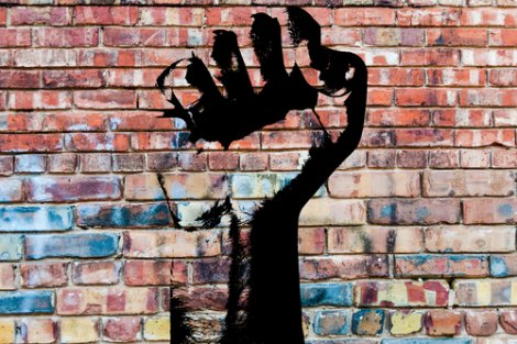 Graffiti fist on a grungy brick wall