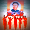 Aim High in Creation actors hold aloft a large photo of Kim Jong-il
