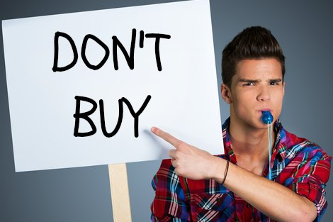 Young man hold's a placard that declares 'Don't buy'