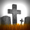 Gravestones in dead grass