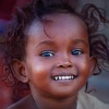 Young smiling dark-skinned girl