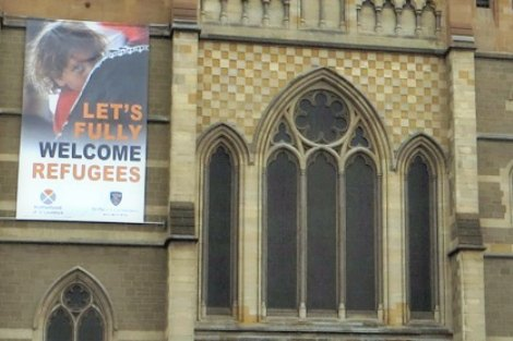 'Let's Fully Welcome Refugees' banner at St Paul's Cathedral Melbourne