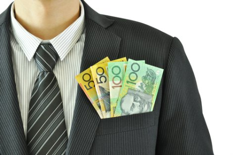 Man in a suit with dollar notes in pocket