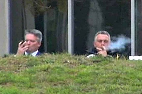 Matthias Corrman and Joe Hockey smoke cigars