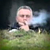 Joe Hockey smokes cigar