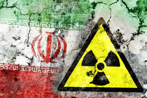 Iran flag and nuclear warning symbol