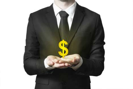 Suited man holding dollar sign