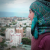 Ghada looks out over the city of Jbeil, Lebanon, where she has lived for nearly a year since her family left Syria (Andy Ash).