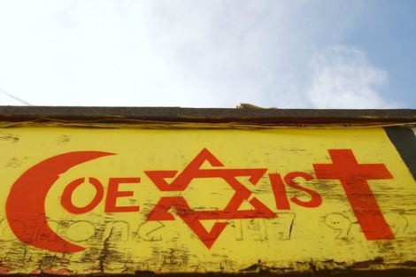 'Coexist' mural on wall