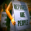 Refugees Are People, Love Makes A Way protestor placards