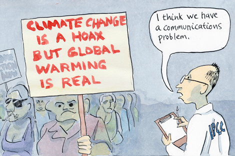 Protestor with sign saying Climate change is a hoax but global warming is real