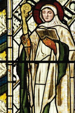 Stained glass image of woman preaching from bible
