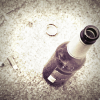 Beer bottle and cigarette butts