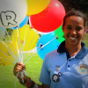 Aboriginal woman with Recognise balloons