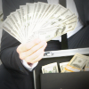Man in suit holding cash