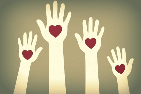Raised hands with hearts on palms