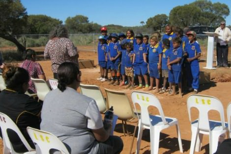 Elders and school children gather at Mount Margaret Mission in the WA's northern Goldfields for the repatriation of Aboriginal remains
