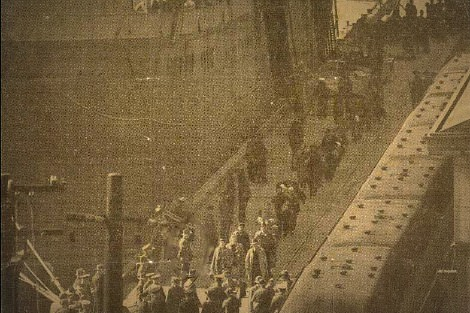 Internees arrive from Britain aboard the Dunera