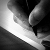 Hand writes in notebook